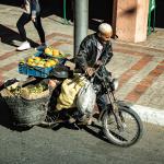 Moped med apelsiner